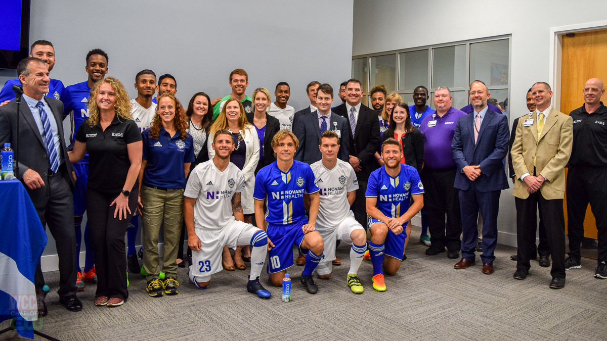 Representatives from Novant Health pose for a photo with the Charlotte Independence team